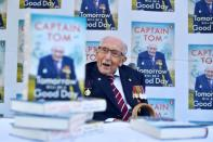 Captain Sir Tom Moore smiles as he launches his autobiography book at his home in Milton Keynes