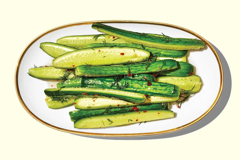 "We love a prep-ahead snack, and this is one of the best for 4th of July. These quick pickles have just the right amount of sweet, salt, and tang going on. The brine can work with any crunchy veg, but we like them best with cucumbers. <a href=""https://www.epicurious.com/recipes/food/views/spicy-lightly-pickled-cucumbers?mbid=synd_yahoo_rss"" rel=""nofollow noopener"" target=""_blank"" data-ylk=""slk:See recipe."" class=""link rapid-noclick-resp"">See recipe.</a>"