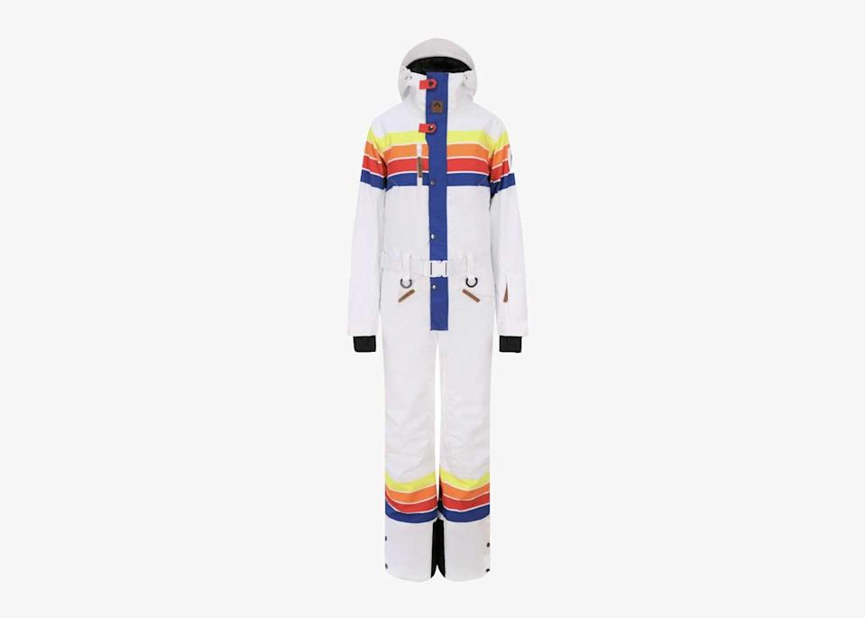 """Oosc brings a playful irreverence to the ski hill with their Ricky Bobby suit, inspired by the early 2000s movie <em>Talladega Nights</em>. The all-white suit with rainbow details is its own 1970s-themed party waiting to happen and will stand out at any socially-distanced outdoor gathering this winter. You can wear this suit in good conscience, too—it's made from 100 percent recycled polyester and each suit is crafted from 50 plastic bottles. $304, Oosc. <a href=""""https://oosc-clothing.com/product/ricky-bobby-ski-suit-womens/"""" rel=""""nofollow noopener"""" target=""""_blank"""" data-ylk=""""slk:Get it now!"""" class=""""link rapid-noclick-resp"""">Get it now!</a>"""