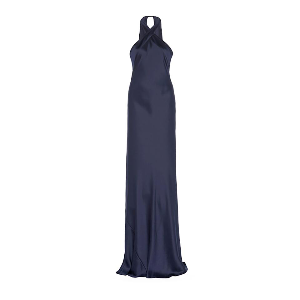 "<p>A classic slip dress is always a go, which Galvan does so elegantly with a halter-twist and deep navy blue, appropriate for any venue.</p> <p><strong>Buy now:</strong> Galvan, $1,695, <a href=""https://www.modaoperandi.com/galvan-fw19/eve-silk-satin-halterneck-gown#zoom"">modaoperandi.com</a>.</p>"