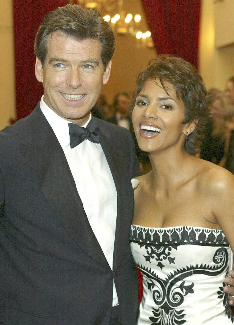 "Pierce Brosnan and Halle Berry at the London premiere of ""Die Another Day."" (Photo: Anwar Hussein via Getty Images)"