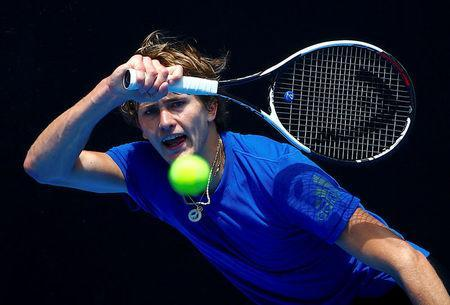 FILE PHOTO: Tennis - Australian Open - Melbourne Park, Melbourne, Australia, January 10, 2018. Germany's Alexander Zverev hits a shot during a practice session ahead of the Australian Open tennis tournament. REUTERS/David Gray/File Photo