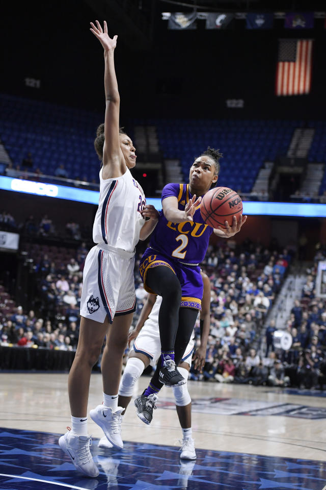 East Carolina's Lashonda Monk goes up to the basket as Connecticut's Olivia Nelson-Ododa defends during the second half of an NCAA college basketball game in the American Athletic Conference tournament quarterfinals, Saturday, March 9, 2019, at Mohegan Sun Arena in Uncasville, Conn. (AP Photo/Jessica Hill)