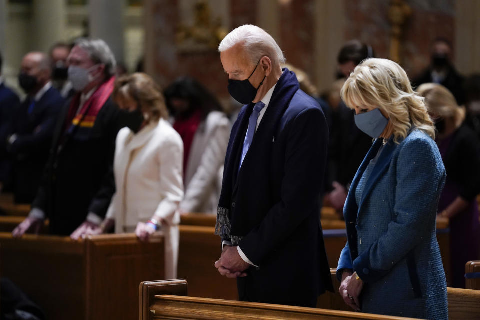 FILE - In this Wednesday, Jan. 20, 2021 file photo, President-elect Joe Biden and his wife, Jill Biden, attend Mass at the Cathedral of St. Matthew the Apostle during Inauguration Day ceremonies in Washington. When U.S. Catholic bishops hold their next national meeting in June 2021, they'll be deciding whether to send a tougher-than-ever message to President Joe Biden and other Catholic politicians: Don't partake of Communion if you persist in public advocacy of abortion rights. (AP Photo/Evan Vucci, File)