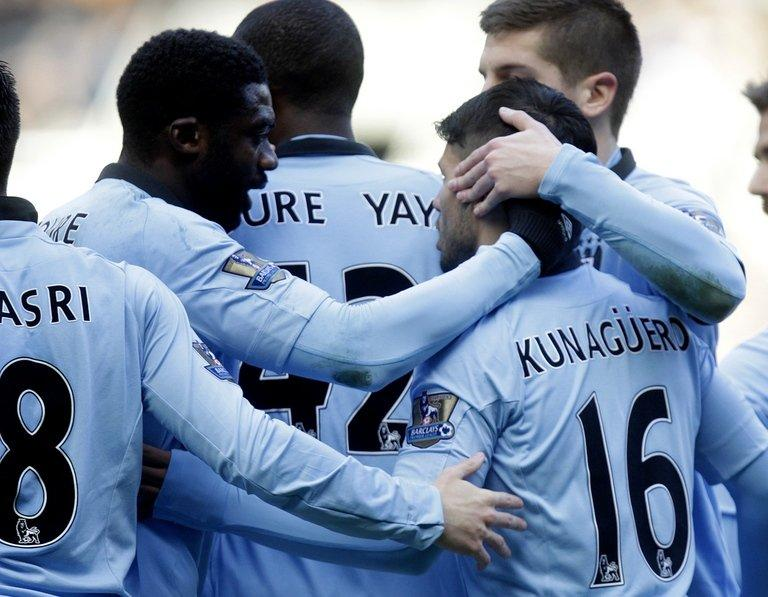 Manchester City's players celebrate scoring a goal against Newcastle, at St James Park, on December 15, 2012