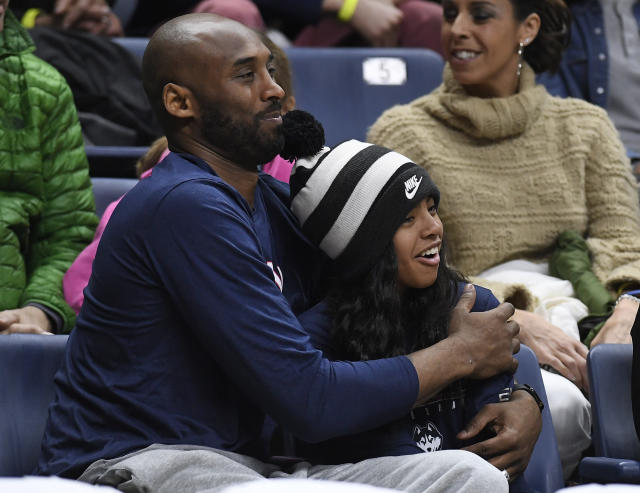 Kobe Bryant and his daughter, Gianna, watch the first half of a UConn basketball game in March 2019 in Storrs, Connecticut. (AP Photo/Jessica Hill)