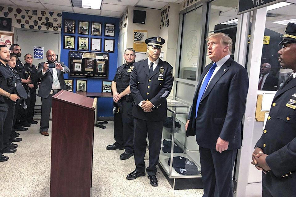 Former President Donald Trump, second from right, commemorated the 20th anniversary of the Sept. 11 attacks by visiting the NYPD's 17th police precinct in New York, where he criticized President Biden over the pullout from Afghanistan Sept 11 20th Anniversary, New York, United States - 11 Sep 2021