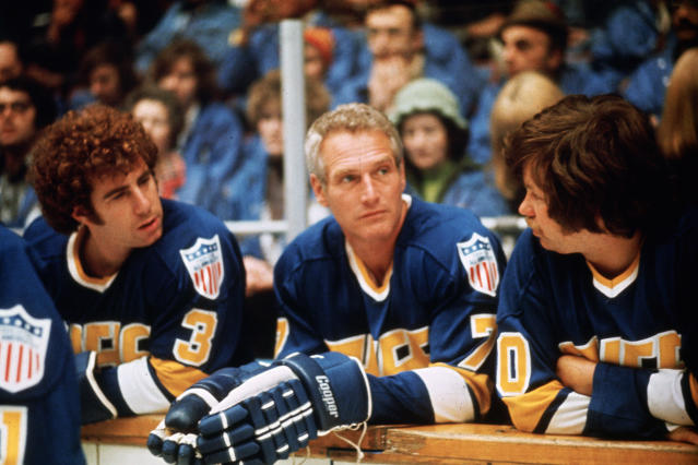 "This undated photo provided Courtesy of Universal Pictures shows actors Jerry Houser, left, and Paul Newman, center, in a scene from the movie ""Slap Shot."" ""Slap Shot"" was No. 5 in The Associated Press' Top 25 favorite sports movies poll. (Courtesy of Universal Pictures via AP)"