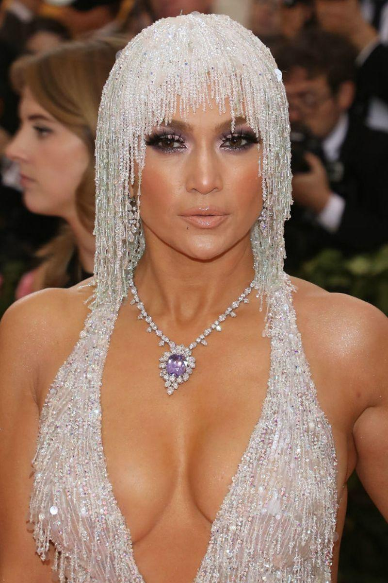 <p>JLo might be the only person on earth to make a crystal raindrop headdress look natural.</p>