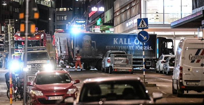 Sources close to the investigation say the suspect, bloodied from the crash and with shattered glass on his clothes, fled from the stolen beer truck, pictured on April 8, 2017, and ran into the nearby subway station (AFP Photo/Fredrik SANDBERG)