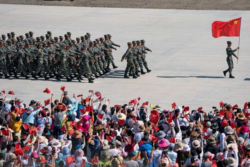 FILE PHOTO: Chinese soldiers of People's Liberation Army (PLA) march during the opening ceremony of four contests hosted by China as part of International Army Games 2019 in Korla, Xinjiang