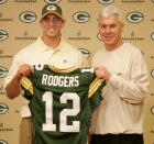 FILE - In this April 24, 2005, file photo, Green Bay Packers general manager Ted Thompson stands next to the team's first-round pick, California quarterback Aaron Rodgers, during an NFL football a news conference in Green Bay, Wis. Thompson, whose 13-year run as Green Bay Packers general manager included their 2010 Super Bowl championship season, died Wednesday, Jan 20, the team announced Thursday, Jan. 21, 2021. He was 68. Thompson was Packers general manager from 2005-17 and drafted many notable players on the current roster, including two-time MVP quarterback Aaron Rodgers. (AP Photo/Mike Roemer, File)