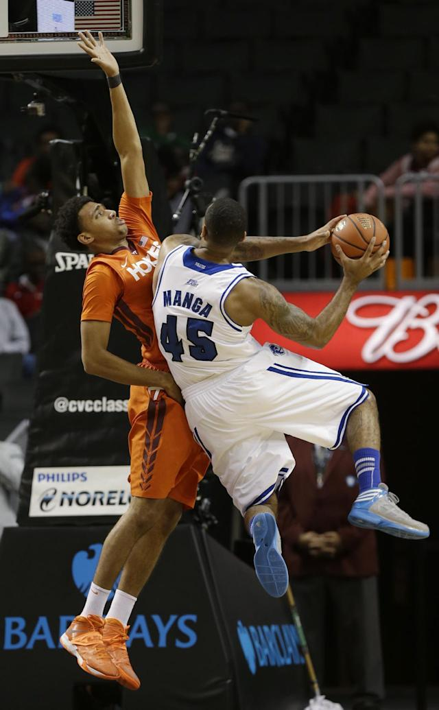 Virginia Tech's Marshall Wood, left, defends against Seton Hall's Stephane Manga during the first half of a consolation game in the Coaches vs. Cancer NCAA college basketball game on Saturday, Nov. 23, 2013, in New York. (AP Photo/Frank Franklin II)