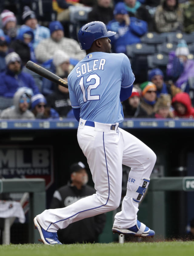 Kansas City Royals' Jorge Soler watches his RBI double during the third inning of a baseball game against the Chicago White Sox Saturday, March 30, 2019, in Kansas City, Mo. (AP Photo/Charlie Riedel)