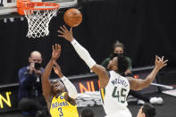Utah Jazz guard Donovan Mitchell (45) defends against Indiana Pacers guard Aaron Holiday (3) in the first half of an NBA basketball game Friday, April 16, 2021, in Salt Lake City. (AP Photo/Rick Bowmer)