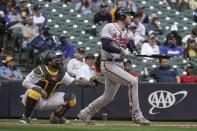 Atlanta Braves' Freddie Freeman hits a grand slam during the seventh inning of a baseball game against the Milwaukee Brewers Sunday, May 16, 2021, in Milwaukee. (AP Photo/Morry Gash)