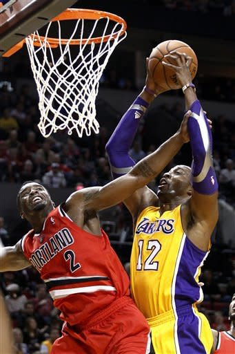 Los Angles Lakers center Dwight Howard, right, is fouled while shooting by Portland Trail Blazers guard Wesley Matthews during the first quarter of an NBA basketball game in Portland, Ore., Wednesday, Oct. 31, 2012. (AP Photo/Don Ryan)