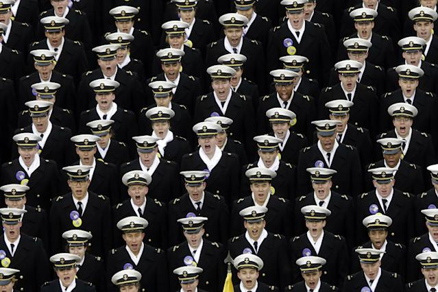 Navy midshipmen shout before the first half of an NCAA college football game against the Army, Saturday, Dec. 14, 2013, in Philadelphia. (AP Photo/Matt Rourke)
