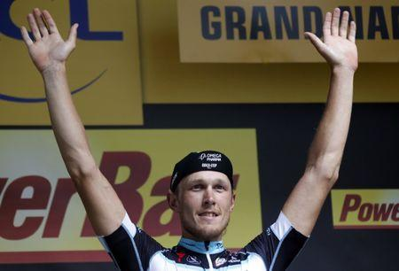 File photo: Omega Pharma-Quick Step team rider Matteo Trentin of Italy celebrates on the podium after winning the 234.5 km seventh stage of the Tour de France cycling race from Epernay to Nancy July 11, 2014. REUTERS/Jean-Paul Pelissier