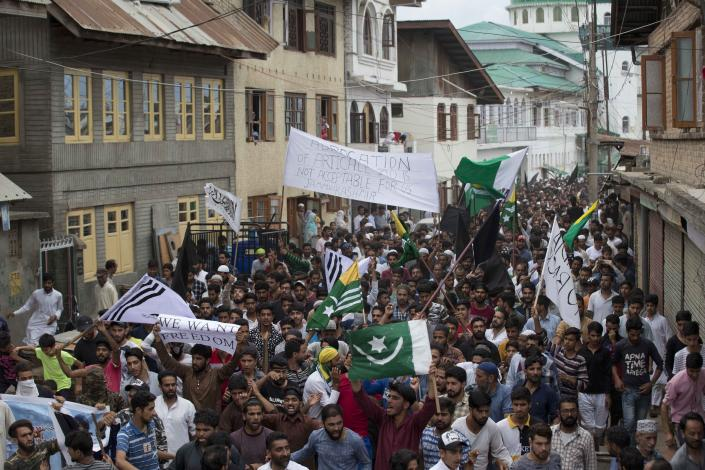 Protestors shout slogans and march on a street after Friday prayers in Srinagar, Indian controlled Kashmir, Friday, Aug. 9, 2019. A strict curfew in Indian-administered Kashmir in effect for a fifth day was eased Friday to allow residents to pray at mosques, officials said, but some protests still broke out in the disputed region despite thousands of security forces in the streets as tensions remained high with neighboring Pakistan. (AP Photo/ Dar Yasin)