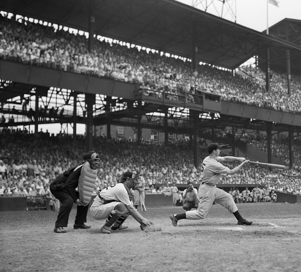 (Original Caption) 6/30/41 Washington, D.C.: Joe DiMaggio, ball-thumping outfielder of the New York Yankees, slashes out the single that broke George Sisler's nineteen-year-old record for hitting safely in consecutive games. The historic hit came in the 6th inning of the second game of a double-header between the Yanks and the Washington Senators, bringing jolting Joe's streak to 42 games in which he has hit safely.