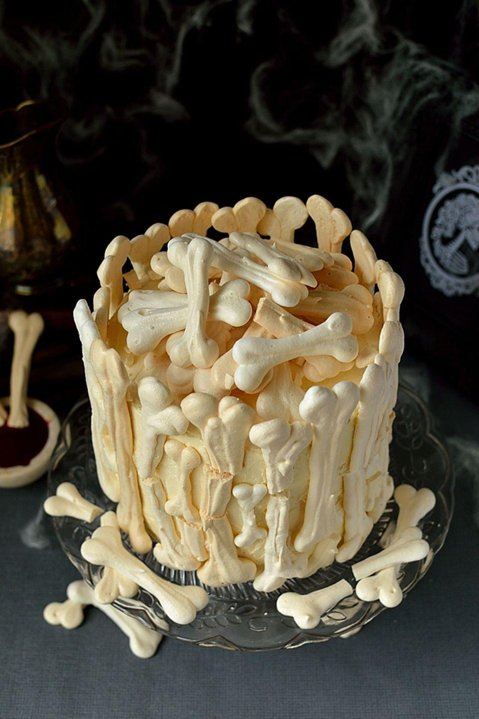 """<p>Your guests will freak when they see this creepy cake. Top the meringue bones with berry coulis """"blood"""" to give them a little extra spook. </p><p><strong>Get the recipe at <a href=""""http://domesticgothess.com/blog/2016/10/05/meringue-bone-palace-halloween-cake/"""" rel=""""nofollow noopener"""" target=""""_blank"""" data-ylk=""""slk:Domestic Gothess"""" class=""""link rapid-noclick-resp"""">Domestic Gothess</a>.</strong> </p>"""