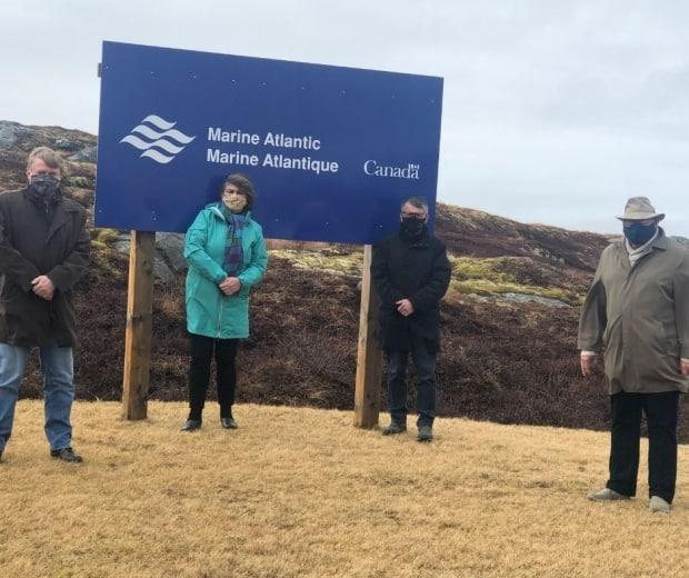 Marine Atlantic shared this photo of its executives and politicians Tuesday, announcing that its plan for a new office building in Port Aux Basques had been approved. (Marine Atlantic/Facebook - image credit)