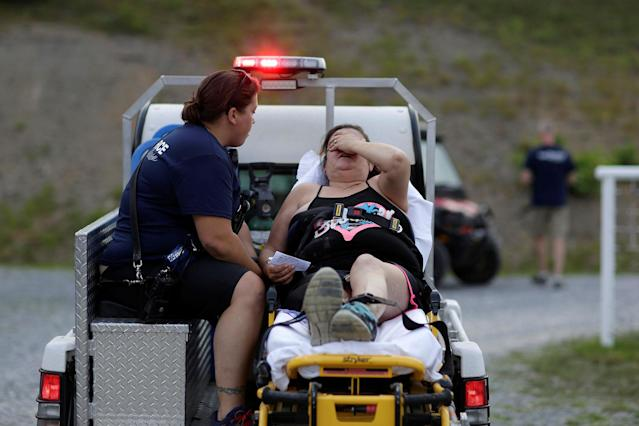 <p>A woman is taken for treatment after she collapsed at the Remote Area Medical Clinic in Wise, Va., July 21, 2017. (Photo: Joshua Roberts/Reuters) </p>