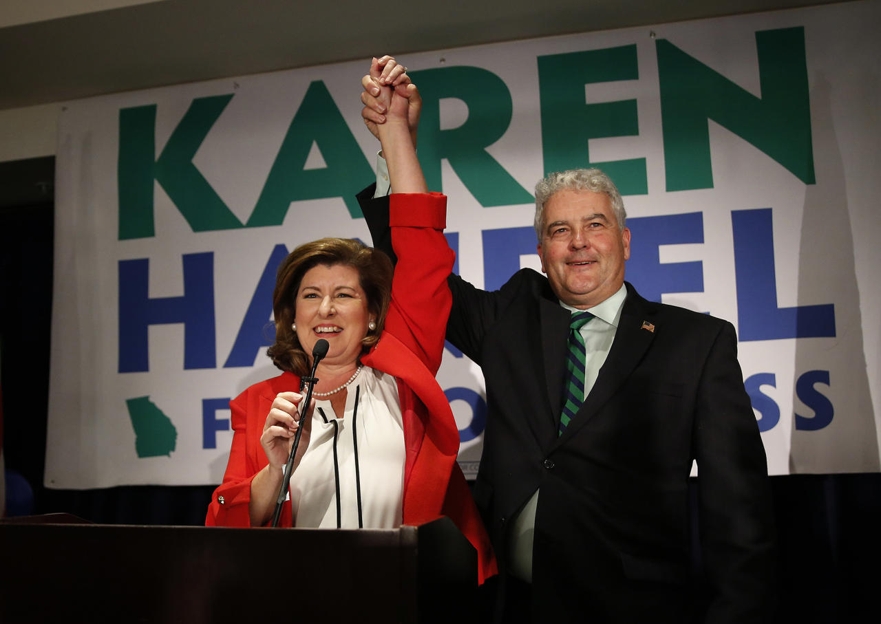 <p>Republican candidate for Georgia's 6th District Congressional seat Karen Handel celebrates with her husband Steve as she declares victory during an election-night watch party Tuesday, June 20, 2017, in Atlanta. (Photo: John Bazemore/AP) </p>
