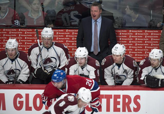 Colorado Avalanche coach Patrick Roy yells out from behind the bench as his team faces the Montreal Canadiens during first period NHL hockey action Tuesday, March 18, 2014 in Montreal. (AP Photo/The Canadian Press, Paul Chiasson)