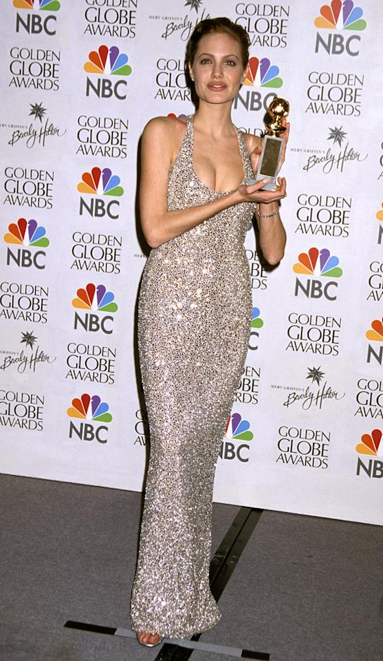 """10. 56th Annual Golden Globe Awards (1999)   The then 24-year-old outshone her well-deserved trophy -- which she won for her work in the HBO made-for-TV movie, """"Gia"""" -- in a bedazzled, champagne-colored halter dress and ruby red lips."""