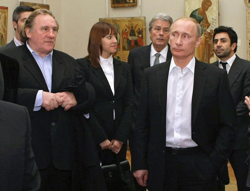 FILE - In this Saturday, Dec. 11, 2010 file photo Russian Prime Minister Vladimir Putin, right, and French actor Gerard Depardieu, left, attend the Russian Museum, in St. Petersburg. Gerard Depardieu, the French actor who has been sparring with his native country over taxes, has been granted Russian citizenship. A brief announcement on the Kremlin website said President Vladimir Putin signed the citizenship grant on Thursday Jan. 3, 2013. (AP Photo/RIA Novosti, Alexei Nikolsky, Pool)