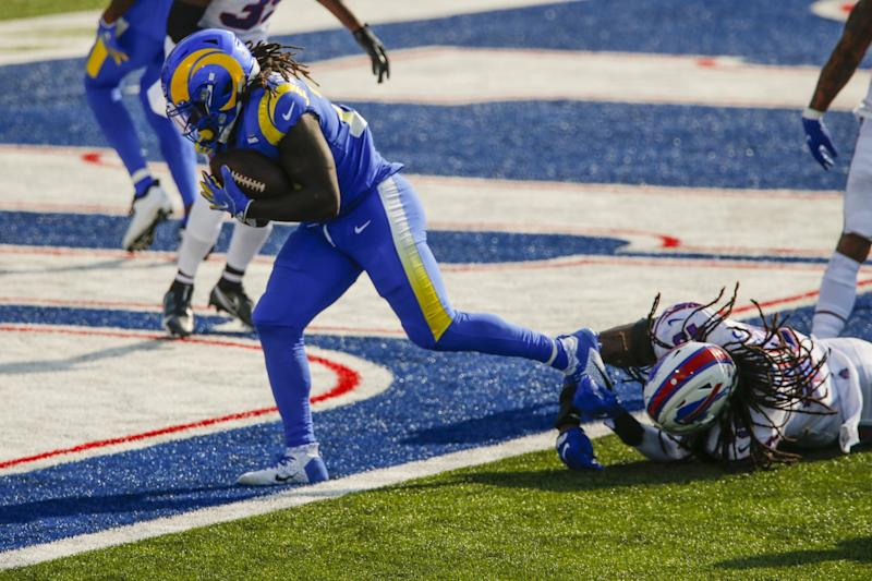 Darrell Henderson breaks a tackle by Buffalo Bills' Tremaine Edmunds to score a touchdown.