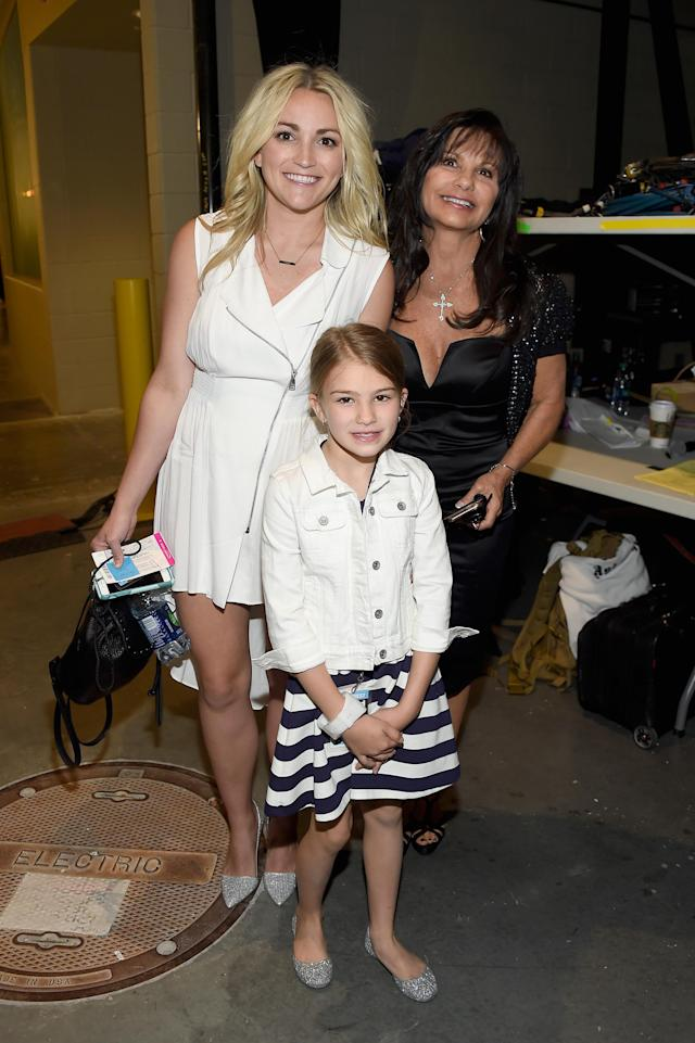Jamie Lynn Spears, pictured with mom Lynne Spears and daughter Maddie Briann Aldridge, is catching heat for a photo of the girl holding a gun. (Photo: Getty Images)
