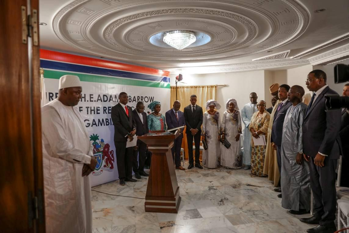 Officials gather at the inauguration ceremony of Gambia President Adama Barrow (L) at the Gambian embassy in Dakar, Senegal January 19, 2017 in this handout photo provided by Office of the Senegal Presidency.  Picture taken January 19, 2017. REUTERS/Office of the Senegal Presidency/Handout THIS IMAGE HAS BEEN SUPPLIED BY A THIRD PARTY. IT IS DISTRIBUTED, EXACTLY AS RECEIVED BY REUTERS, AS A SERVICE TO CLIENTS. EDITORIAL USE ONLY