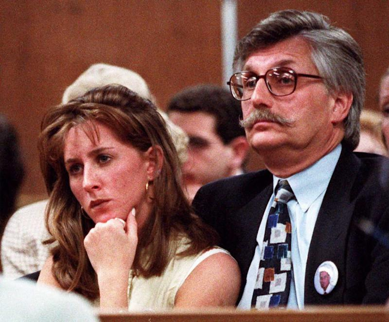 SANTA MONICA, CA - JUNE 25: Kim Goldman (L) and Fred Goldman (R) sister and father of murder victim Ronald Goldman listen to Superior Court Judge Alan Haber in a Santa Monica, California, court 25 June during a court session in the wrongful death lawsuit against O.J. Simpson. Simpson was acquitted October 1995 of the 12 June 1994 murders of his ex-wife Nicole and Goldman, 25, a waiter friend. (Photo credit should read AFP/AFP/Getty Images)