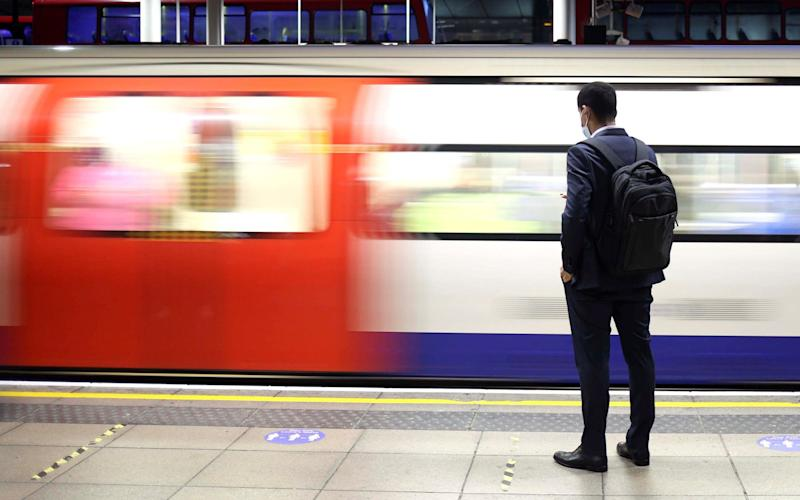 A man waits on the platform for a tube train amid the coronavirus disease (COVID-19) pandemic in London, in October 2020 - HANNAH MCKAY/Reuters
