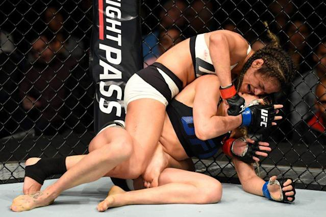 Cynthia Calvillo sinks in a submission on Pearl Gonzalez during their UFC 210 bout. (Getty)