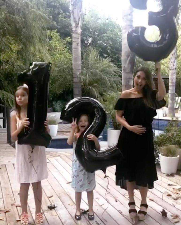 "<p>For her July <a rel=""nofollow"">pregnancy announcement</a> — the actress and husband Cash Warren are <a rel=""nofollow"">expecting their third child</a> — Jessica Alba poses alongside daughters <a rel=""nofollow"">Haven Garner</a>, 6, and <a rel=""nofollow"">Honor Marie</a>, 9, in McGuire's <a rel=""nofollow"">The Wild Years Off the Shoulder Dress</a> ($215).  <strong>Finish the Look!</strong> Women's Strappy Slingback Platform Wedge Sandals ($17 to $31), <a rel=""nofollow"">amazon.com</a></p>"