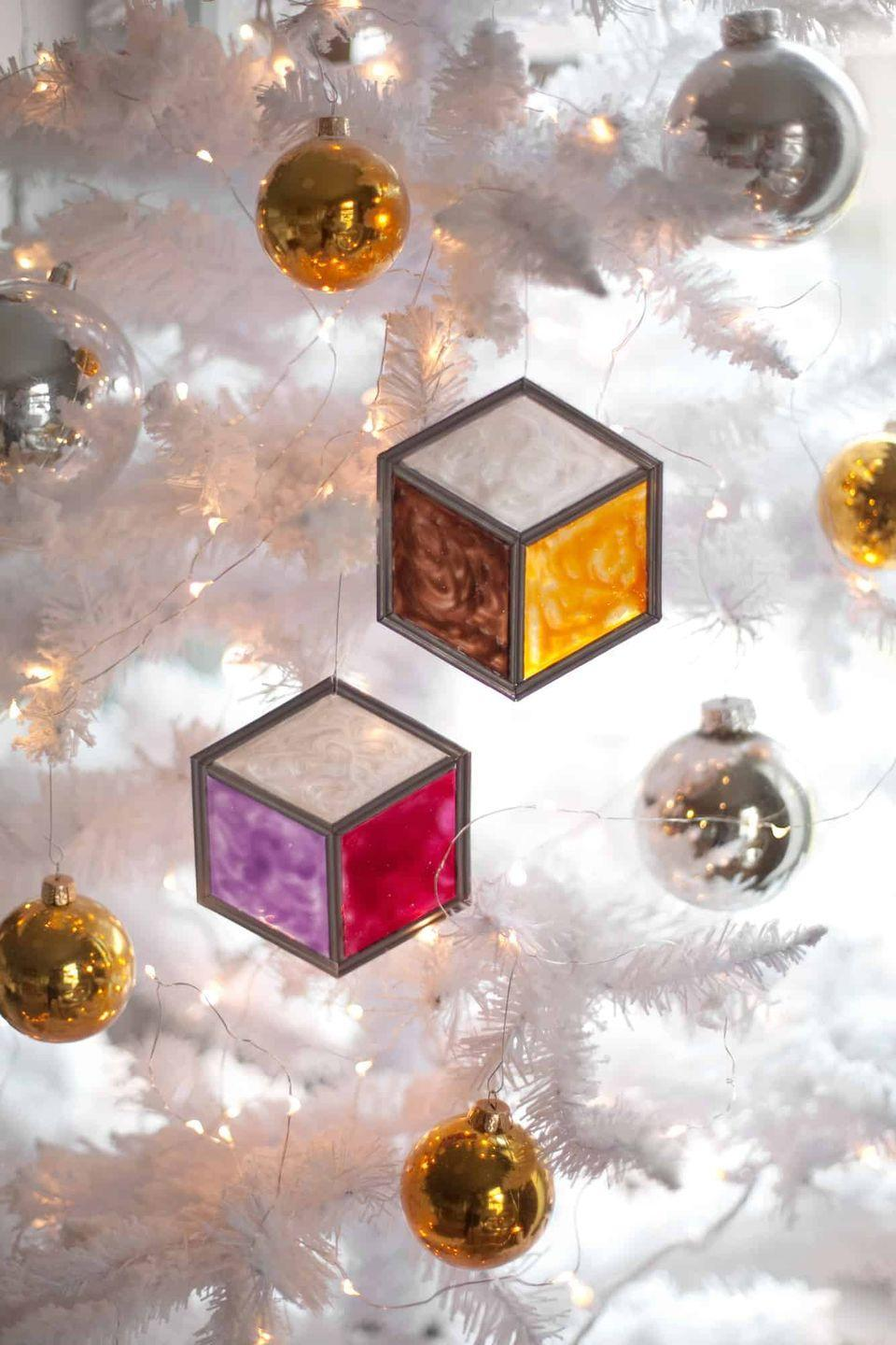 """<p>You don't actually need any glass to make this cool and colorful ornament—just some plexiglass and paint. </p><p><em>Get the tutorial at <a href=""""https://abeautifulmess.com/stained-glass-tumbling-block-ornaments/"""" rel=""""nofollow noopener"""" target=""""_blank"""" data-ylk=""""slk:A Beautiful Mess"""" class=""""link rapid-noclick-resp"""">A Beautiful Mess</a>.</em></p><p><a class=""""link rapid-noclick-resp"""" href=""""https://www.amazon.com/gp/product/B01N7MLF3D?tag=syn-yahoo-20&ascsubtag=%5Bartid%7C10072.g.34443405%5Bsrc%7Cyahoo-us"""" rel=""""nofollow noopener"""" target=""""_blank"""" data-ylk=""""slk:SHOP PLEXIGLASS"""">SHOP PLEXIGLASS</a></p>"""