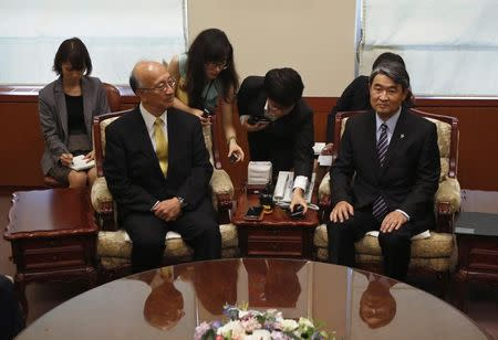 South Korea's Vice FM Cho and Japanese Ambassador to South Korea Bessho at the foreign ministry in Seoul