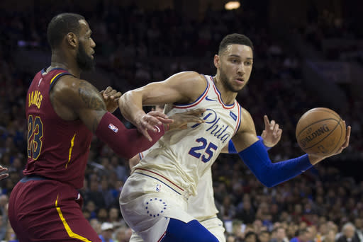 PHILADELPHIA, PA – APRIL 6: Ben Simmons #25 of the Philadelphia 76ers controls the ball against LeBron James #23 of the Cleveland Cavaliers in the first quarter at the Wells Fargo Center on April 6, 2018 in Philadelphia, Pennsylvania. (Photo by Mitchell Leff/Getty Images)