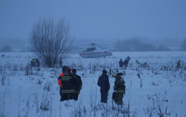 <p>Emergency services work at the scene where a short-haul regional Antonov AN-148 plane crashed after taking off from Moscow's Domodedovo airport, outside Moscow, Russia on Feb. 11, 2018. (Photo: Maxim Shemetov/Reuters) </p>