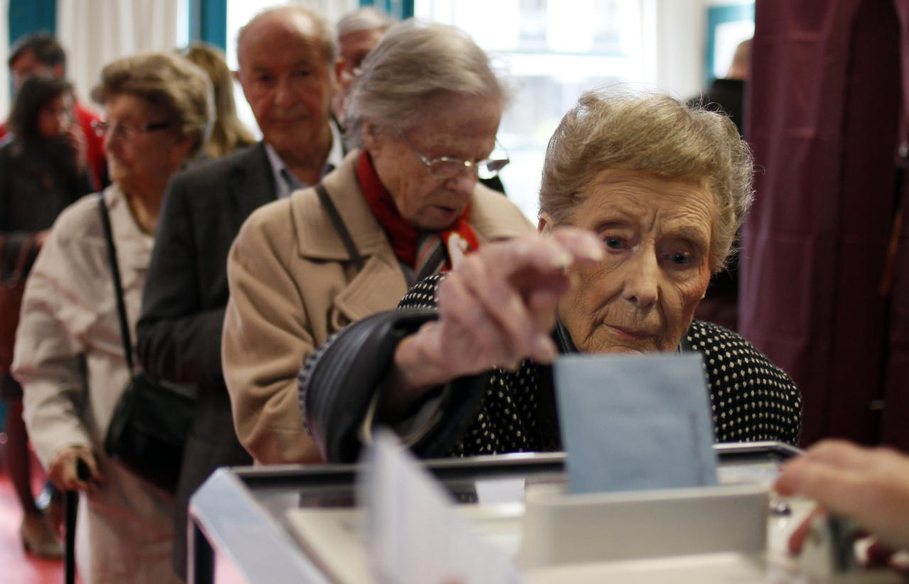 A woman casts her ballot during the first round of the French elections in Lille, northern France, Sunday, April 22, 2012. (AP Photo/Michel Spingler)