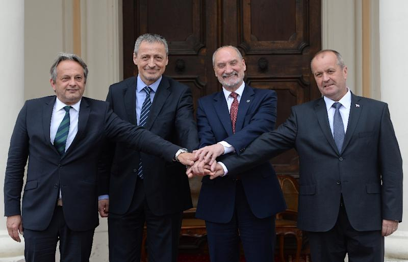 (L-R) Hungarian Deputy Minister of Defence Tamas Vargha, Czech Republic's Minister of Defense Martin Stropnicky, Polish Defence Minister Antoni Macierewicz and Slovak Defence Minister Peter Gajdos pose on May 25, 2016 in Liblice, Czech Republic
