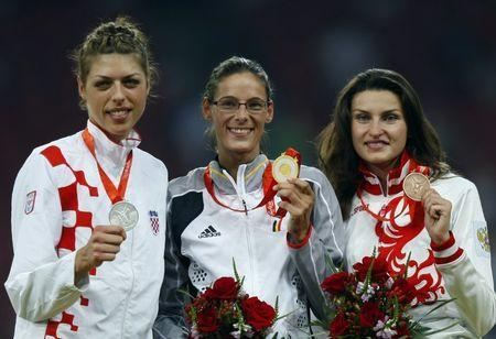 Women's high jump medallists (L-R) Blanka Vlasic of Croatia (silver), Tia Hellebaut of Belgium (gold) and Anna Chicherova of Russia (bronze) pose on podium during the medals ceremony of the athletics competition in the National Stadium at the Beijing 2008 Olympic Games August 23, 2008. REUTERS/Mike Blake (CHINA) - BR1E48N1PMQ5R