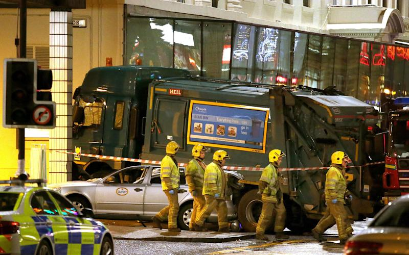 Emergency services on the scene after the bin lorry crash - Andrew Milligan/PA