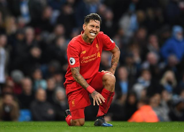 <p>Roberto Firmino is frustrated after missing an opportunity to score </p>