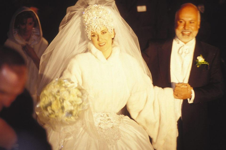 <p>Sleek and simple was definitely not the name of the game when Celine Dion wore an ornate seven-pound crystal tiara for her wedding to her manager Rene Angelil on December 17th, 1994. The tiara was a big trend for '90s brides—although most brides chose much simpler tiaras for their big days. </p>