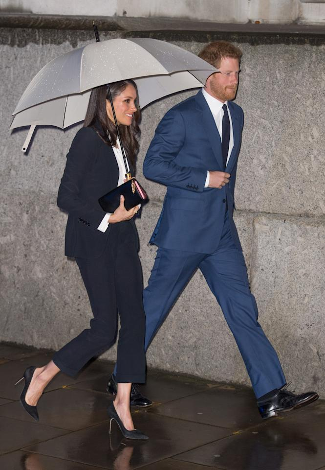 <p>Meghan donned a black wool Alexander McQueen pant suit for the Endeavour Fund Awards in February. The blazer alone cost £1,245, with the trousers coming in at £575. She teamed it with a Tuxe Bodywear Boss Blouse and Manolo Blahnik heels [Photo: PA] </p>